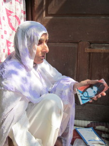 Syeda shows pictures of her dead son.